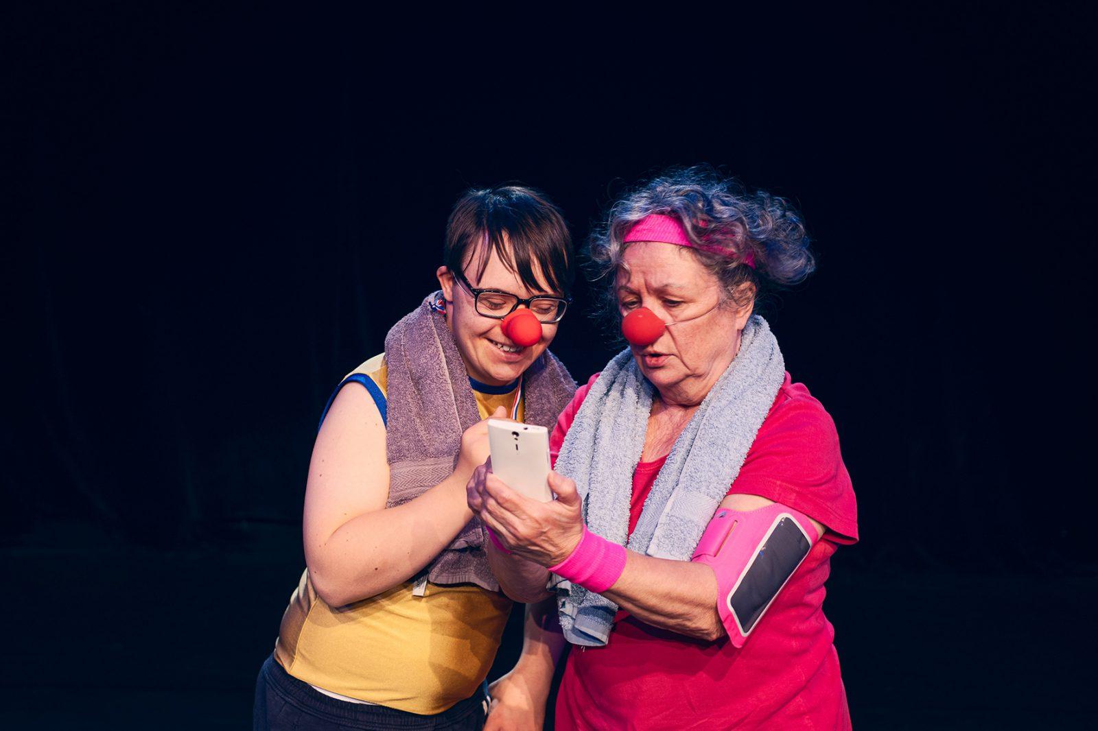 zwei Clowns mit Handy